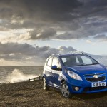 Chevrolet Spark Blue Beach Background Wallpaper